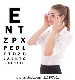 young beautiful business woman in glasses and eye test chart isolated on white background
