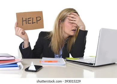 young beautiful business woman suffering stress working at office computer desk asking for help feeling tired and desperate looking overworked covering eyes overwhelmed and frustrated