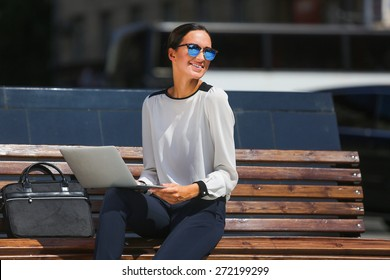 Young beautiful business woman working on a laptop