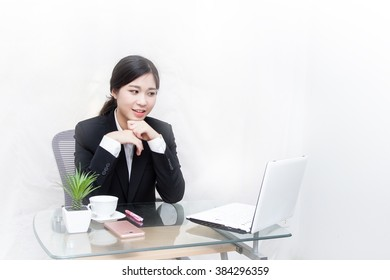 Young beautiful business woman working with notebook computer in the office