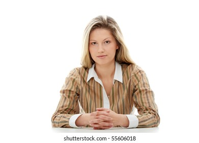Young beautiful businesswoman behind the desk, isolated
