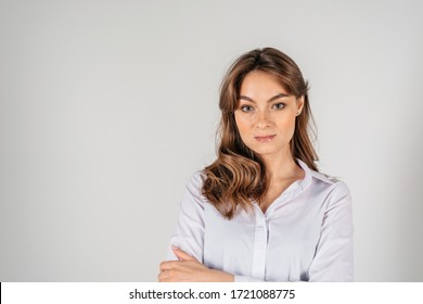 Young beautiful businesswoman over white background wearing white shirt smiling and looking in the camera