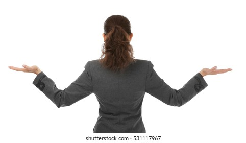 Young beautiful businesswoman standing back on white background