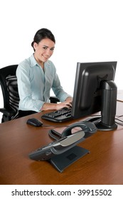 Young, beautiful businesswoman typing at the computer at work, happy and smiling, isolated on white background