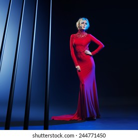 young beautiful caucasian blonde in gorgeous dress
