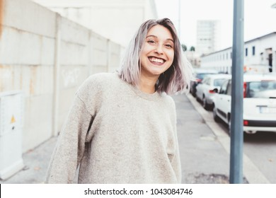 Young beautiful caucasian purple grey hair woman outdoor in the city having fun looking camera - happiness, freedom, dancing concept
