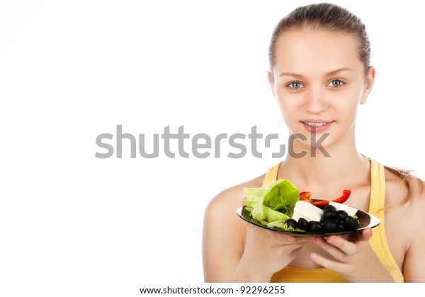 Young Beautiful Caucasian Woman Eating Vegetable Stock Photo