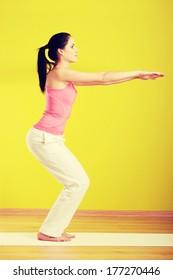 Young beautiful caucasian woman exercising at home