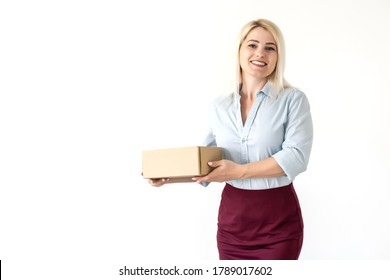 A young beautiful caucasian woman holding a box in her hands.