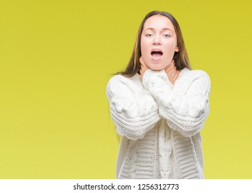 Young beautiful caucasian woman wearing winter sweater over isolated background shouting and suffocate because painful strangle. Health problem. Asphyxiate and suicide concept.