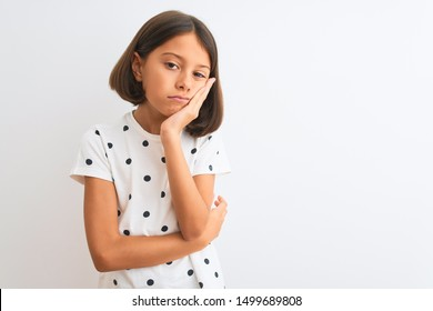 Young beautiful child girl wearing casual t-shirt standing over isolated white background thinking looking tired and bored with depression problems with crossed arms.