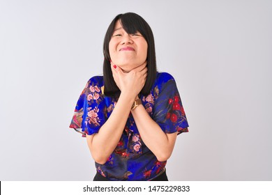 Young beautiful chinese woman wearing summer floral t-shirt over isolated white background shouting and suffocate because painful strangle. Health problem. Asphyxiate and suicide concept.