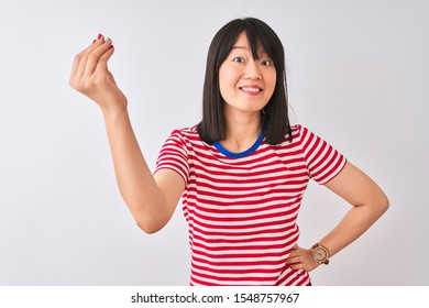 Young beautiful chinese woman wearing red striped t-shirt over isolated white background Doing Italian gesture with hand and fingers confident expression
