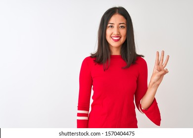 Young beautiful chinese woman wearing red dress standing over isolated white background showing and pointing up with fingers number three while smiling confident and happy.