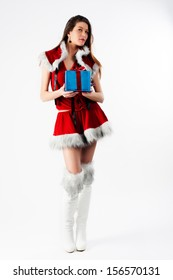 young beautiful Christmas woman with gift at white background