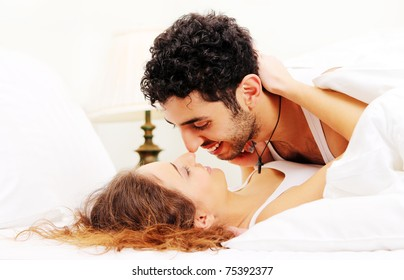 Young and beautiful couple in bed