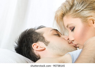 young beautiful couple in bed