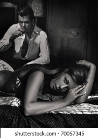 Young beautiful couple in bedroom in black and white