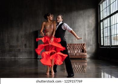 young beautiful couple dancing tango