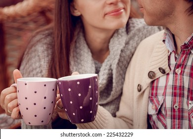 Young beautiful couple drinking tea outdoors