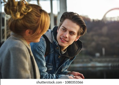 Young beautiful couple enjoying their time. Man and woman laugh and talk