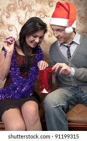 Young and beautiful couple exchanged Christmas gifts