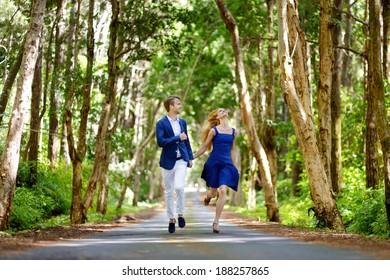 Young beautiful couple having fun in a park