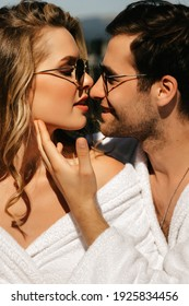 Young beautiful couple hugging and kissing on vacation. High quality photo