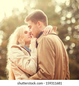 Young beautiful couple in love in park
