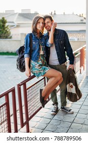 Young beautiful couple in love posing outdoor in summer have fun on the street