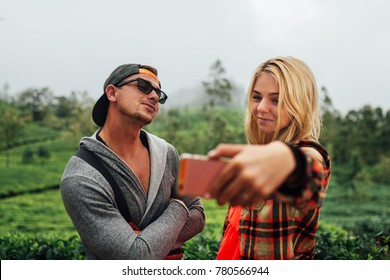 Young beautiful couple making a selfie in shilanka green prairie