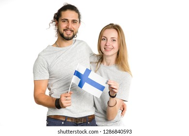 Young beautiful couple, man and woman, with the flag of Finland in their hands isolated on white background.