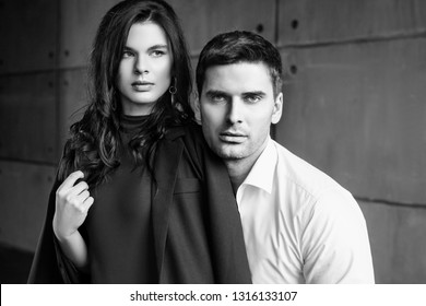 Young beautiful couple in ogirinal loft interior