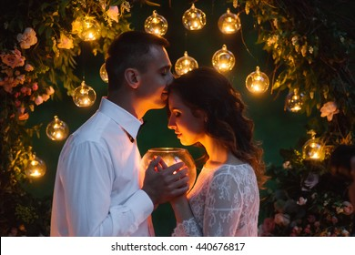 Young beautiful couple on the night wedding ceremony in the forest.