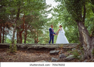 Young beautiful couple in the park. Happy wedding.