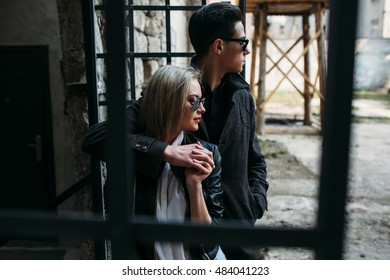 young beautiful couple posing on the background of an old building