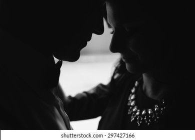 Young beautiful couple silhouette in Black and White
