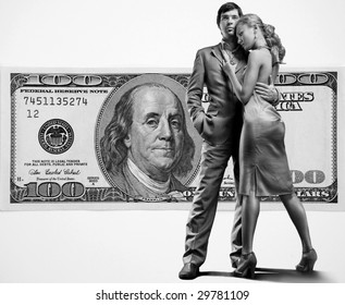 Young beautiful couple under money