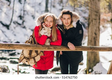 Young beautiful couple in winter in the forest