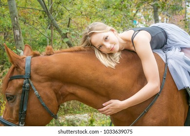 young beautiful dancer, posing with a horse in the Woods, flexible gymnast. in the forest