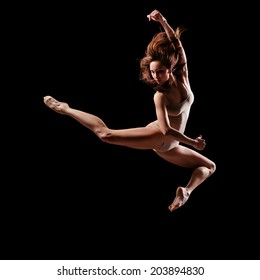 young beautiful dancer posing on studio black background