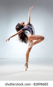 young and beautiful dancer posing in studio
