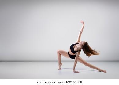young beautiful dancer teen girl dancing and jumping, studio series