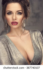 Young beautiful elegant woman portrait. Sexy lady posing in expensive evening dress with decollete