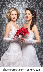 Young, beautiful and emotional brides with a beautiful flowers over vintage background