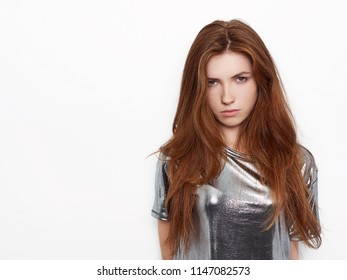 Young beautiful excited woman with gorgeous natural red hair green eyes, blank copy space on white background for advertisement or promotional text