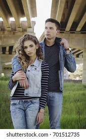 Young beautiful fashion couple wearing jeans clothes in daylight.