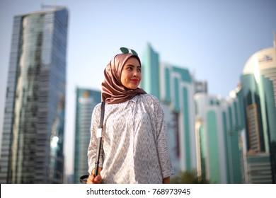 Young beautiful fashion hijab women posing with urban city background