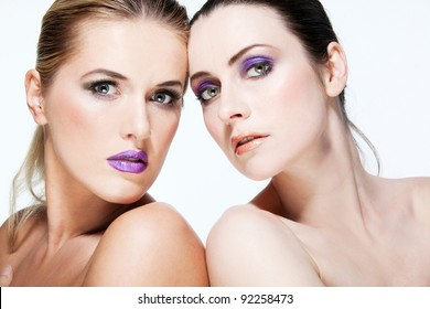 Young beautiful fashion models with full make up.