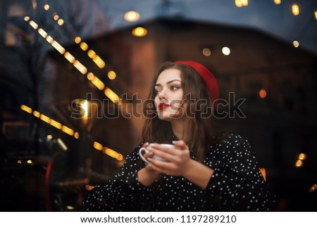 8299bb6b Young beautiful fashionable girl with red lips, long hair, wearing french  style beret,